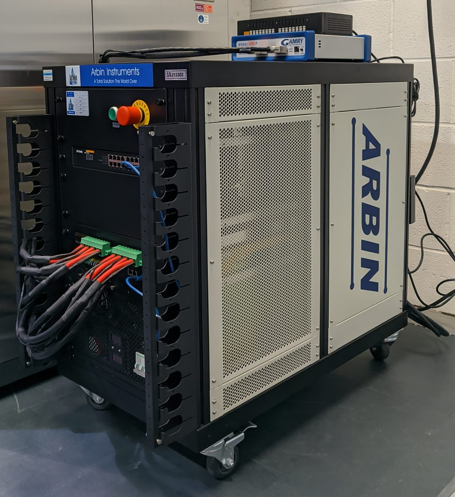 Image of an Arbin LBT21084 Cell tester connected to a Gamry EIS unit with cables coming out to connect to the test set up
